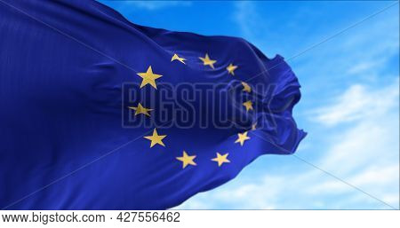 The Flag Of The European Union Flapping In The Wind. Economic And Finance Community. Politics And Ec