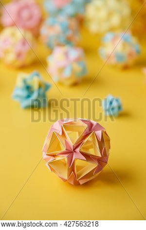 Set Of Multicolorhandmade Modularorigami Balls Or Kusudama Isolated On Yellow Background. Visual A