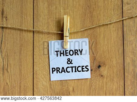Theory And Practice Symbol. White Paper With Words 'theory And Practice', Clip On Wooden Clothespin.