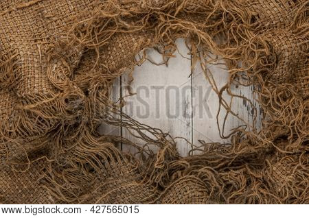 Burlap texture on white wooden table background. Wooden table with sacking. Copy space