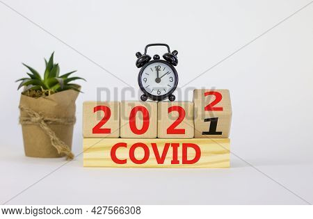 Covid-19 Pandemic In 2022 Symbol. Turned A Wooden Cube And Changed Words 'covid 2021' To 'covid 2022