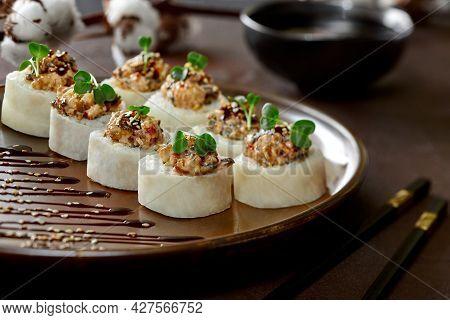 Sushi Rolls In Mamenori With Eel, Cream Cheese, Avocado, Daikon, Unagi Sauce