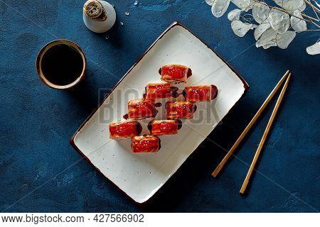 Top View Of Philadelphia Rolls With Salmon, Red Caviar And Unagi Sauce