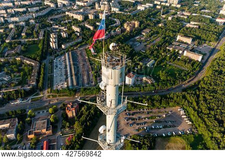 Aerial View Of A Meteorological Mast With A Flag Of Russia And A Panorama Of Urban Development In Th