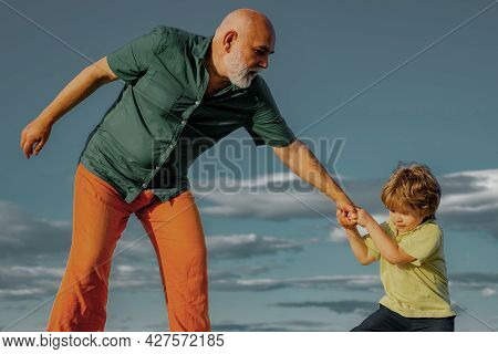 Grandfather Helping Hand Extended Grandson. We Must Educate Our Youngsters Better. Grown Up Rebuking