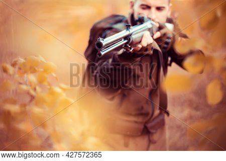 Autumn Hunting Season. Hunter Aiming Rifle In Forest. Barrel Of A Gun.