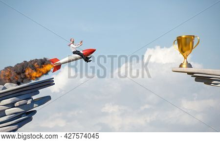 businessman uses a rocket to reach an award. concept of determination.