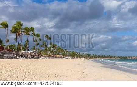 Coastal Caribbean Landscape. Sandy Atlantic Ocean Coast With Palm Trees On A Sunny Day, Bavaro Beach