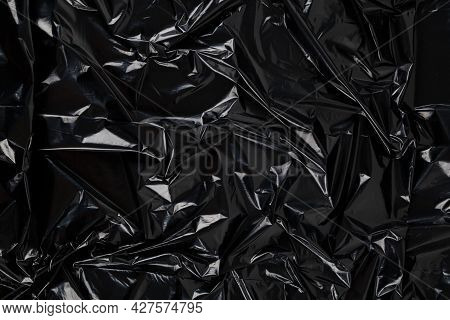 Full Frame Abstract Background Of Crumpled Black Plastic Film Bag