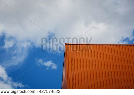 Metallic Cladding On Modern Industrial Building Over Sky Background. Warehouse