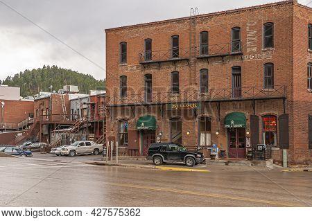 Deadwood Sd, Usa - May 31, 2008: Downtown Main Street. Red Brick Historic Hotel Bullock Back Side Al