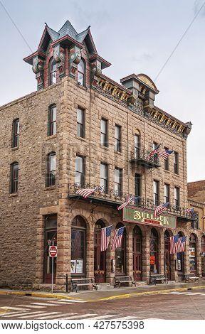 Deadwood Sd, Usa - May 31, 2008: Downtown Main Street. Beige Brick And Stone Historic Hotel Bullock