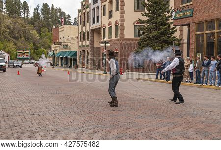 Deadwood Sd, Usa - May 31, 2008: Downtown Main Street. Shootout In The Middle Of Street. Gun Powder