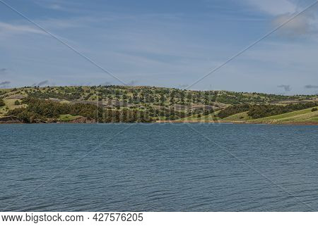 Chamberlain, Sd, Usa - June 2, 2008: Missouri River North Of Town. Green Hilly Agricultural Belt Bet