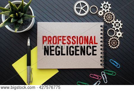 Concept Professional Negligence Message On A White Sticker With Pen On Hands