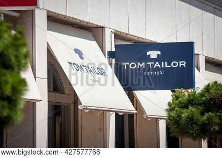Ljubljana, Slovenia - June 13, 2021: Tom Tailor Logo In Front Of Their Shop For Ljubljana. Tom Tailo