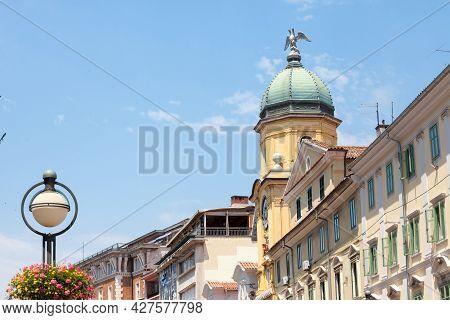 Facades Of The Korzo Street In Rijeka, Croatia, With The City Tower, Or Gradski Toranj, A Baroque Cl