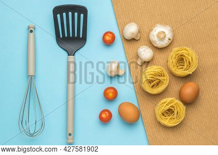 Ingredients For Cooking Pasta With Mushrooms And Tomatoes And Kitchen Utensils. Ingredients For Maki