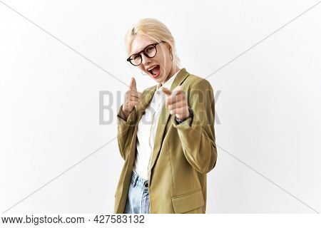 Beautiful caucasian business woman standing over isolated background pointing fingers to camera with happy and funny face. good energy and vibes.
