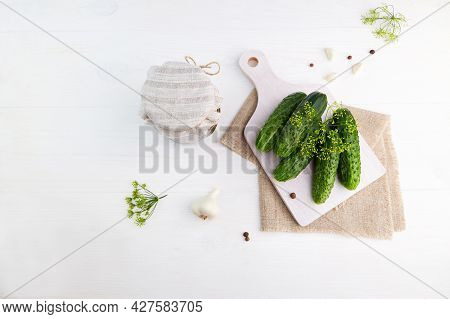 Ingredients For Pickling Cucumbers: Fresh Cucumbers, Dill, Garlic On White Wooden Background. Pickle