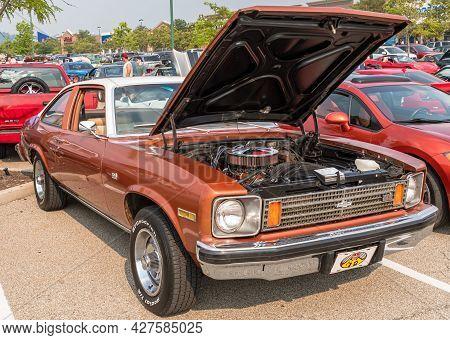 Homestead, Pennsylvania, Usa July 21, 2021 A 1974 Chevrolet Nova Coupe With It's Hood Raised On Disp
