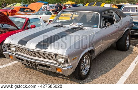 Homestead, Pennsylvania, Usa July 21, 2021 A Vintage Two Toned Silver With Black Stripes Chevrolet N