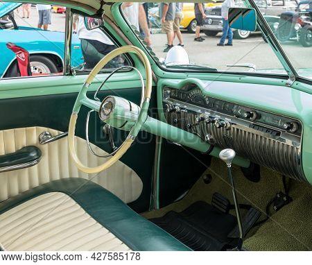 Homestead, Pennsylvania, Usa July 21, 2021 The Steering Wheel, Dashboard Green Interior Of A Vintage