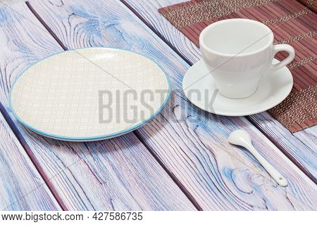 Porcelain Cup With Saucer And Plate On Wooden Background.