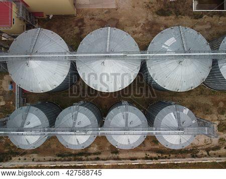 Grain Elevator. Metal Grain Elevator In Agricultural Zone. Agriculture Storage For Harvest. Grain El