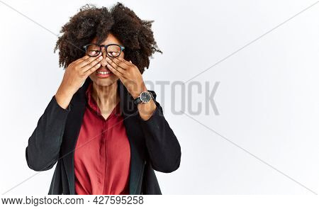 African american woman with afro hair wearing business jacket and glasses rubbing eyes for fatigue and headache, sleepy and tired expression. vision problem