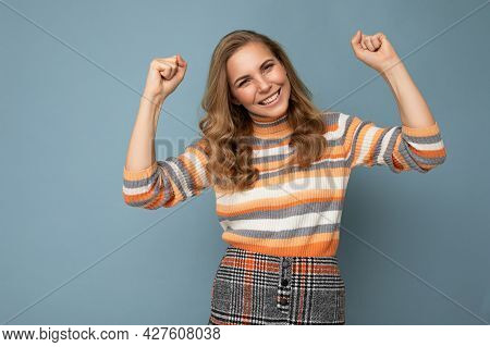 Portrait Of Young Winsome Attractive Happy Smiling Blonde Woman With Wavy-hair Wearing Striped Sweat