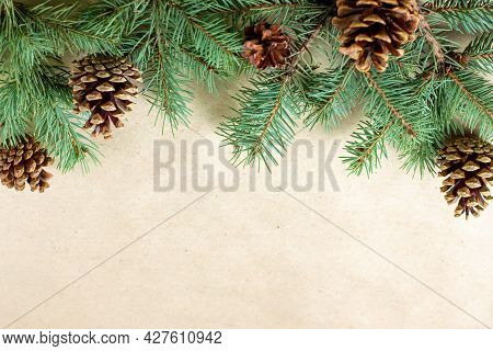 Border Of Fir Tree Branch With Cones On Craft Paper For Christmas Card With Copy Space For Text. Hap