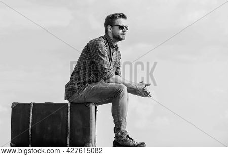 Vacation Time. Travel Agency. Man Sit On Suitcase Before Journey. Business Trip. Handsome Guy Travel
