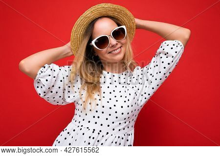 Attractive Young Blonde Woman Wearing Everyday Stylish Clothes And Modern Sunglasses Isolated On Col