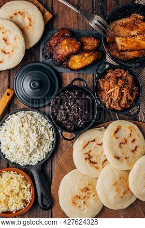 Table Served With Venezuelan Breakfast, Arepas With Different Types Of Fillings Such As Caraotas, Ca