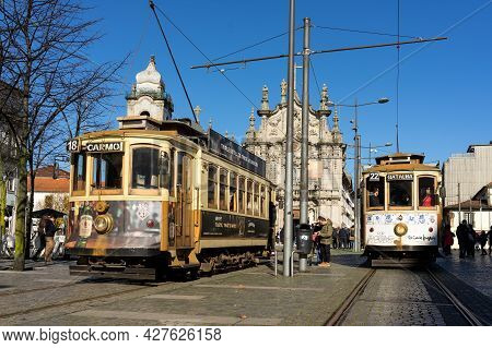 Porto, Portugal - December 01, 2019: Carmen And Carmelitas Churches With The Historic Tram In The Fo
