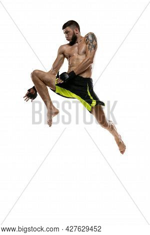 Professional Male Mma Boxer In Motion Isolated On White Studio Background. Fit Muscular Caucasian At