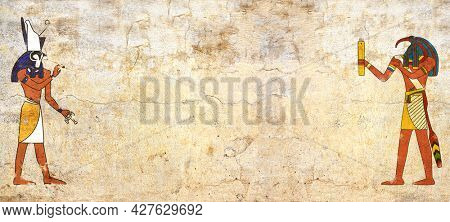 Grunge background with Egyptian gods images Toth and Horus and old stucco texture of beige color. Horizontal banner in egyptian style. Mock up template. Copy space for text
