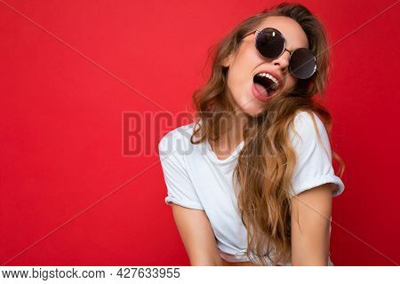 Attractive Amazing Sexy Young Blonde Woman Wearing Everyday Stylish Clothes And Modern Sunglasses Is