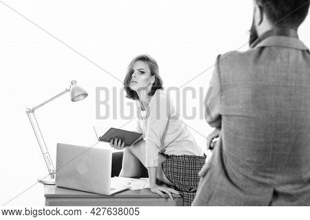 Startup Network. Man In Foreground Looking At Sexy Lady Using Laptop On Desktop. Sensual Office Mana
