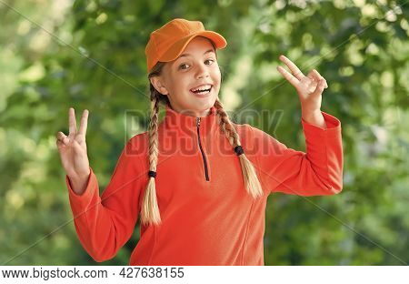 Life Is Fun. Happy Girl Child Show Peace Signs Outdoors. Beauty Look. Fashion Trend. Trendy Style. C