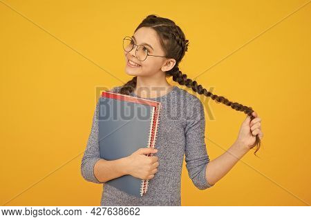 Flights Of Imagination. Girl With Long Plaits Hold Books. Little Dreamer With Thoughtful Look Yellow