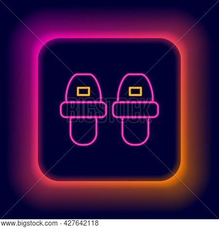 Glowing Neon Line Hotel Slippers Icon Isolated On Black Background. Flip Flops Sign. Colorful Outlin