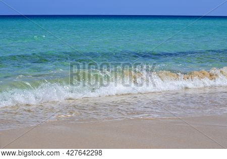 The Horizon, Crystal Clear Blue Sea Water In Various Shades, White Foam And  Wave Flooding The Sandy