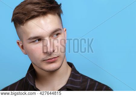 Closeup Portrait Of Young Handsome Man With Sidelong Glance At Right Side. Trendy Hairstyle, Short A