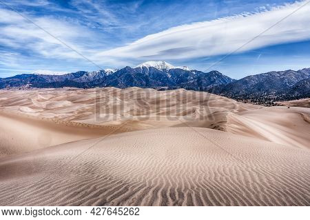 Dunes And Mountains In Great Sand Dunes National Park In Colorado