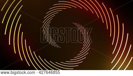 Image of yellow light trail spinning in hypnotic motion. colour, pattern, movement and light concept digitally generated image.