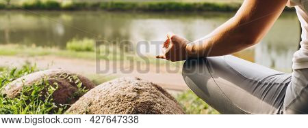 Outdoor Meditation, Banner, Copy Space. Close-up Of A Meditating Young Woman Sitting In A Lotus Posi