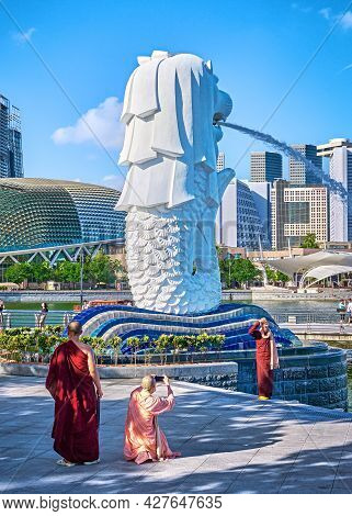 Singapore - Feb 25, 2020. Buddhist Monks And Nuns Take Pictures By Famous Merlion Fountain, Symbol O