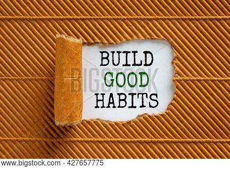 Build Good Habits Symbol. Words 'build Good Habits' Appearing Behind Torn Brown Paper. Beautiful Bro